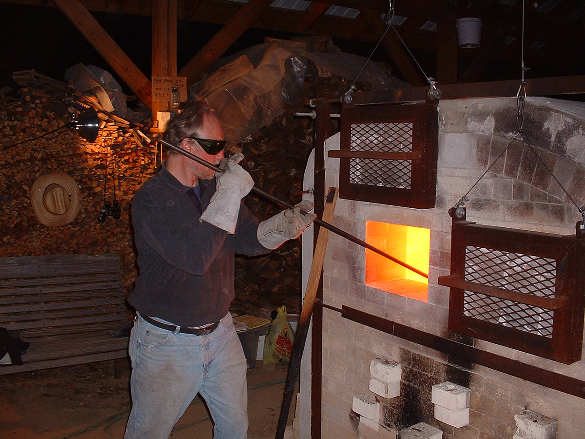 Tony Moore stoking the kiln