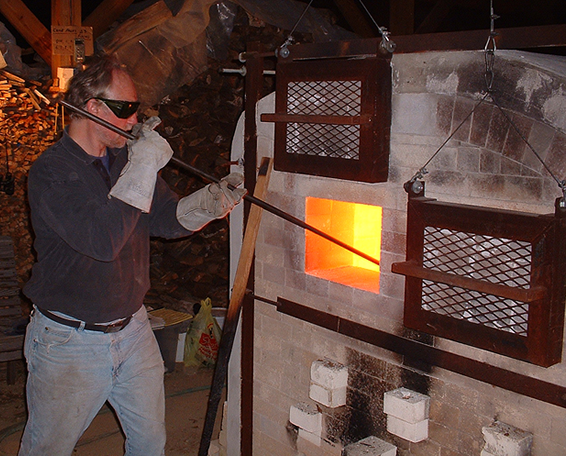 Tony Moore stoking the kiln.